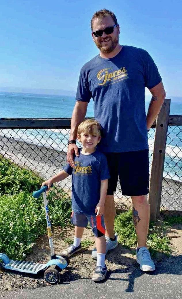 Now cancer-free, 7-year-old Jackson Dupps of Ahwatukee can enjoy the beach with his dad Gregg Dupps.