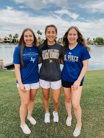 """Cassandra """"Casie"""" Bych, left, and her twin sister Camille """"Cammy"""" Bych flank Willow Brown. The three Ahwatukee teens will be heading to military academies after graduating next week from Desert Vista High School."""