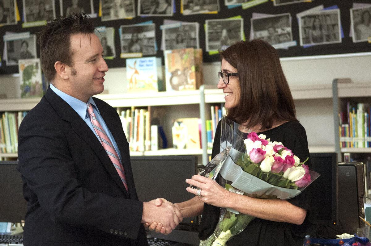 """Tonja Yalung, seen here being congratulated last March by Maricopa County School Superintendent Steve Watson for winning a 2017 Rodel Exemplary Principal Award is principal of Kyrene de los Ninos Elementary School. Though the award is based on a documented history of student achievement growth, a positive school culture and an active engagement of parents and community, the formula for the state's new school-grading system produced a """"C"""" for Ninos."""