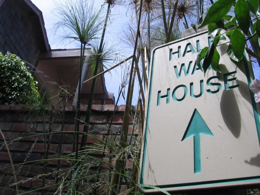 A Novelty Sign Pointing To A Sober Living House In Orange County Was Posted  In