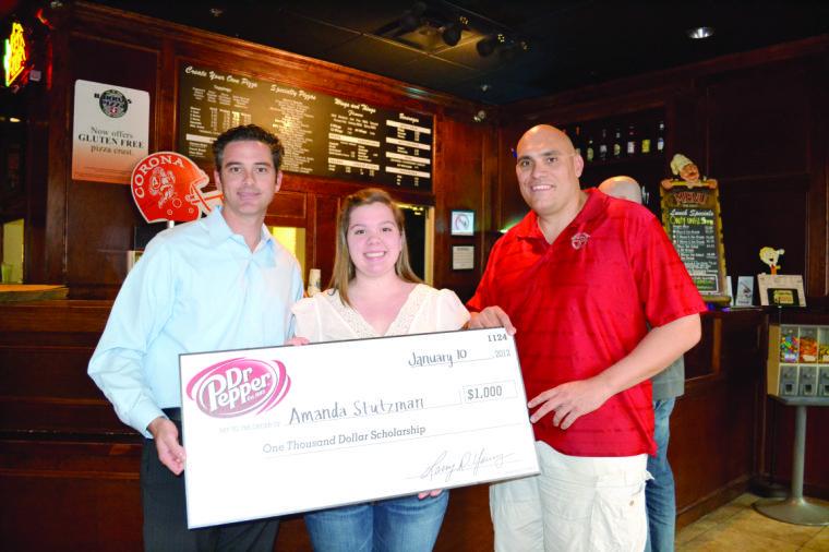Barro's Pizza and Dr. Pepper present $1,000 checks