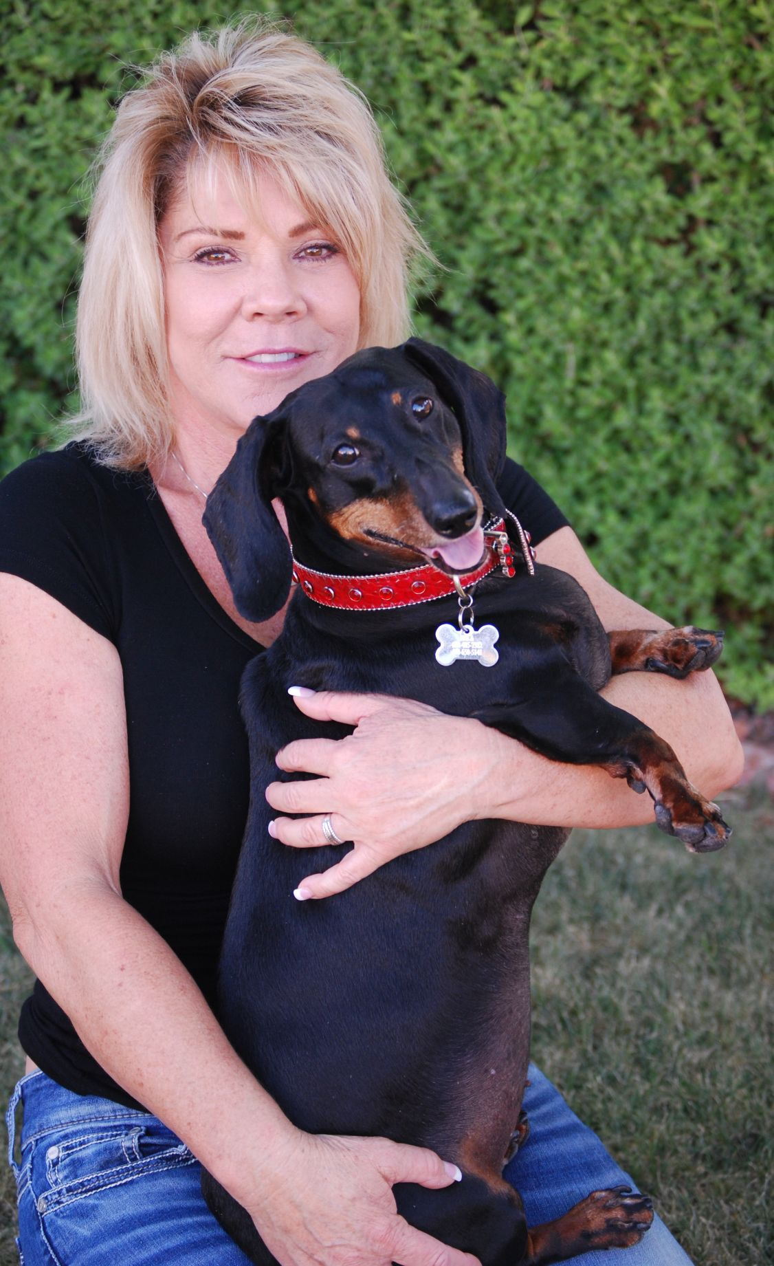 Karen White and her dachshund Ella Marie are preparing for the dog's first appearance at the Wienerschnitzel Weiner Dog Race in California.