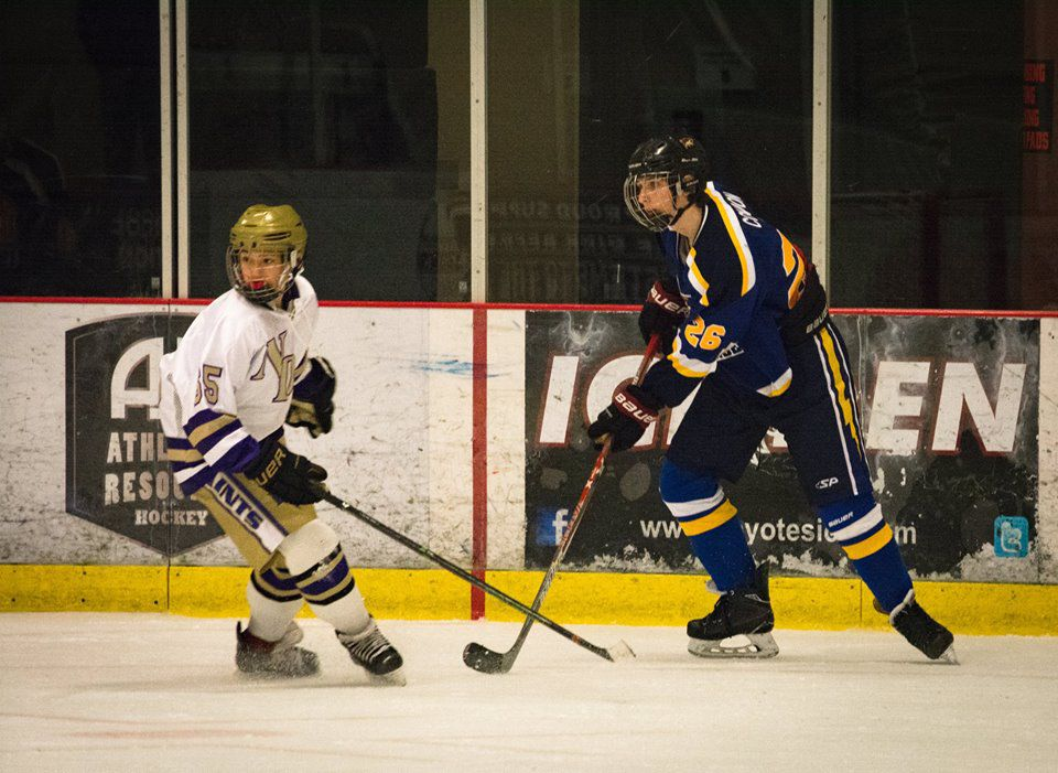 Thunder hockey player James Condon, right, tangles with Logan Lheureux of Notre Dame High School.