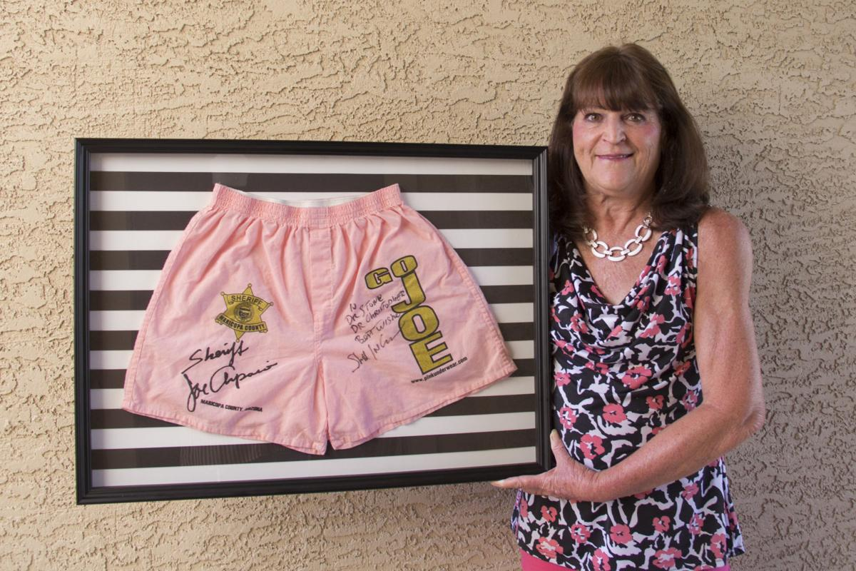 Marjorie Lucas, owner of A Custom Picture Frame in Ahwatukee, framed for one customer a pair of pink shorts that were worn by inmates at the defunct Tent City jail run by former Sheriff Joe Arpaio.