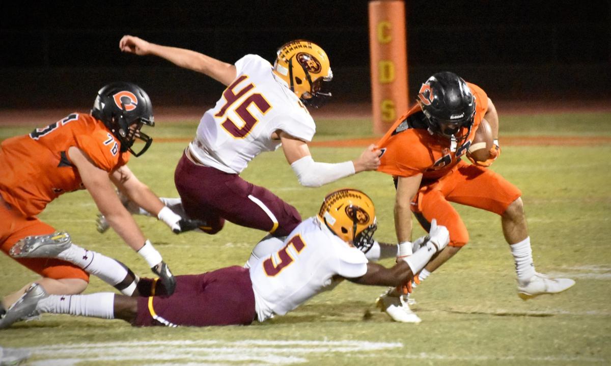 Pride defenders Jacob Olsen, left, and Donte Lindsey pull down Corona's Brandon Gavel.