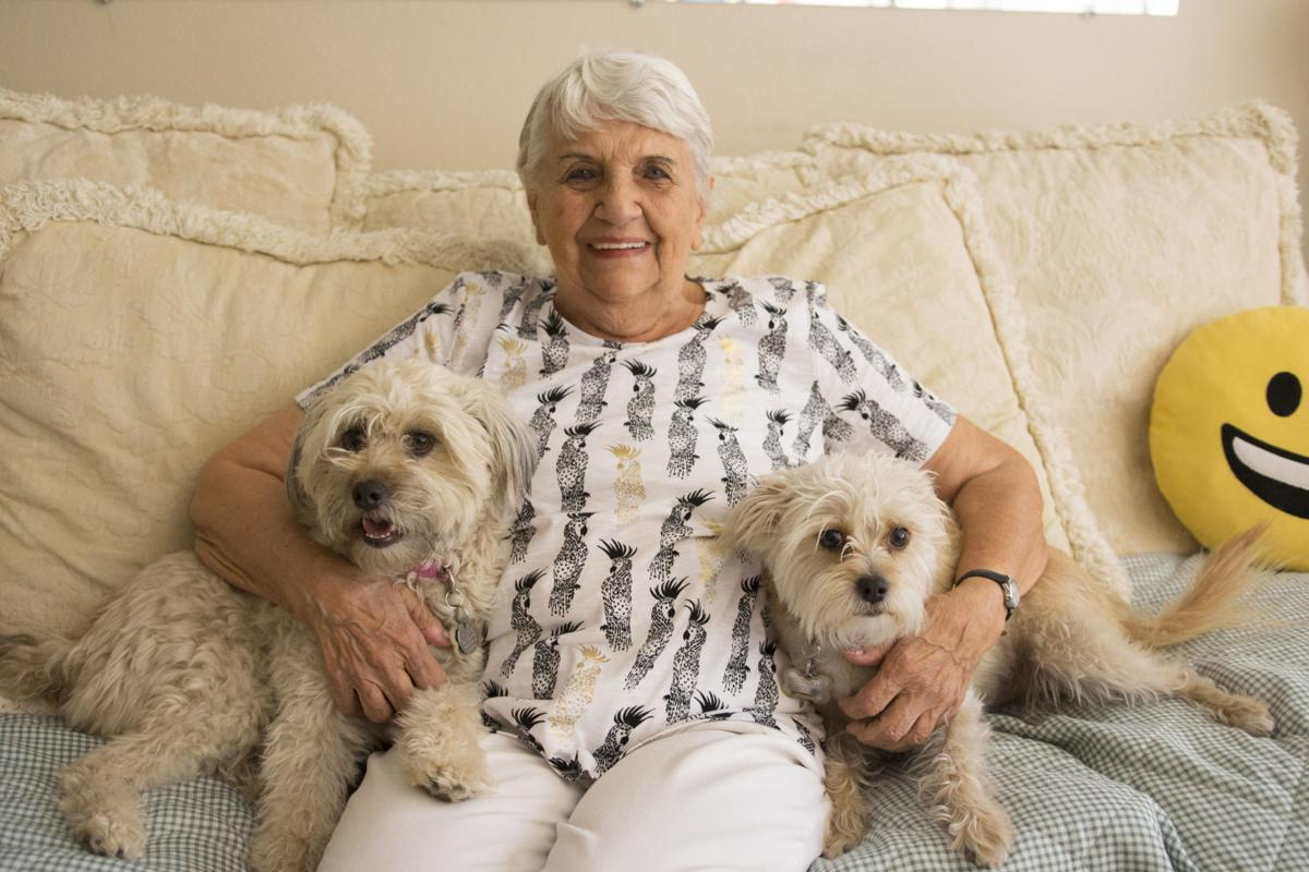 Dolly Dentz with her dogs, Fluffy and Boots