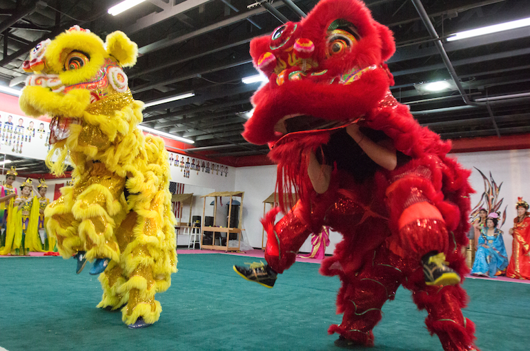 "Elaborate, handmade costumes that include representations of mythological creatures are also part of the Phoenix Wushu Academy's presentation of ""Mulan."""