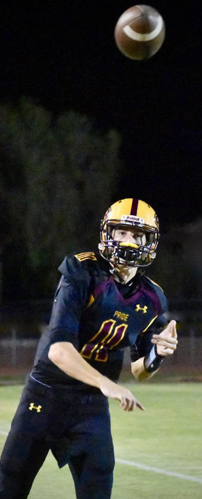 Pride Quarterback Nick Wallerstedt hurls a touchdown pass during the game with Pinnacle High.