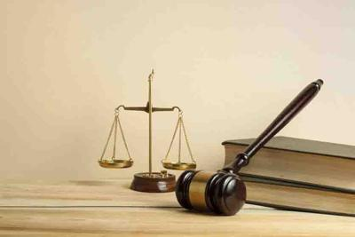 Law concept. Wooden judge gavel,scales of justice and books on table in a courtroom or enforcement office.