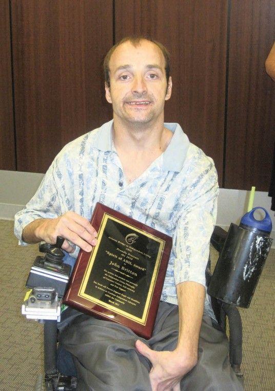 John Britton receives Spirit of ABIL Award