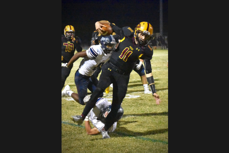 Pride Quarterback Nick Wallerstedt breaks free of a tackle to score the Pride's third touchdown.
