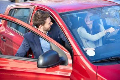Man Getting In Car