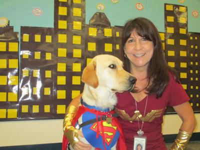 """Esperanza Elementary Principal Cheryl Greene, whose school received an A+ School of Excellence designation, last year introduced a new """"faculty"""" member – a trained assistance dog."""