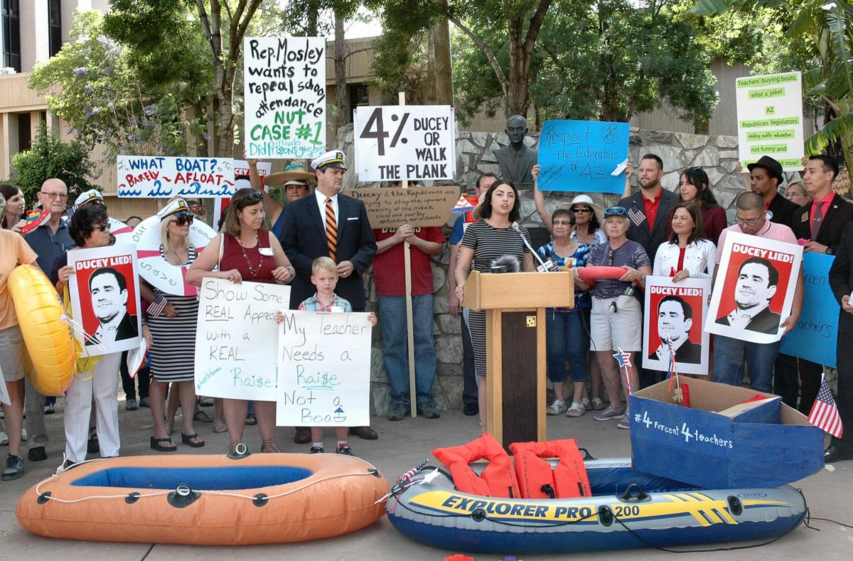 Protesters supporting more pay for teachers gathered last week with boats to ridicule a lawmaker who said teachers should take a second job if they wanted to buy things like a boat.