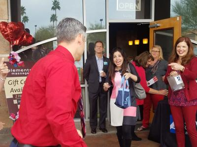 Chamber of Commerce President/CEO Lindy Lutz Cash, right, greets attendees at a recent mixer.