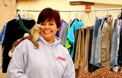 Becky Ornelas hoisted the griffin on her shoulder during her garage sale