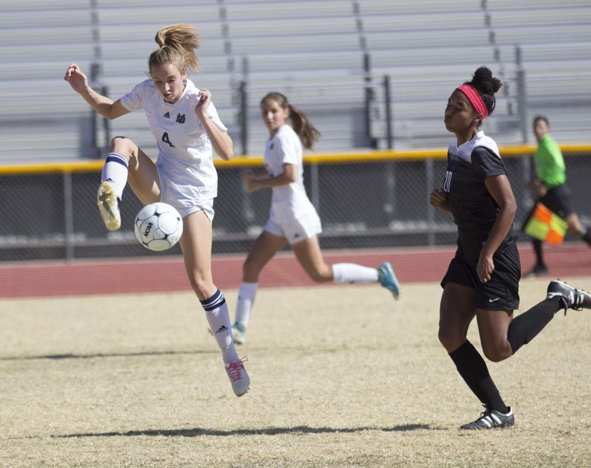 The Thunder's Isabella Glavin settles the ball while Kalia Brown tries to get into the play during Desert Vista girls soccer playoff competition on Saturday, Feb. 3. The girls team lost, but the boys team is going on to a semifinal match today, Feb. 7.