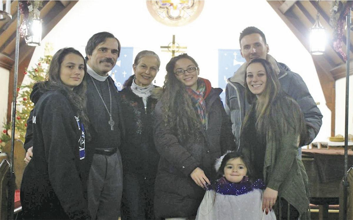 The Rev. Fred Gerlach, second from left, poses with his family, from left, daughter Emily, wife Lenore, daughter Veronica, granddaughter Lana, son-in-law Mike and daughter Katrina.