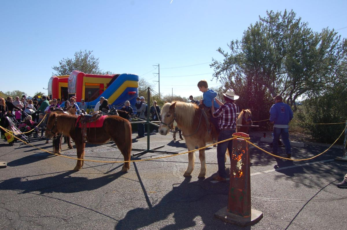 Although motor vehicles steal the show at Transportation Day on the campus of God's Garden Preschool in Ahwatukee, organizers include horses that kids can also try out.