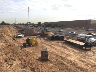 Crews have dug a 300-foot-long cut along I-10 near 55th Avenue