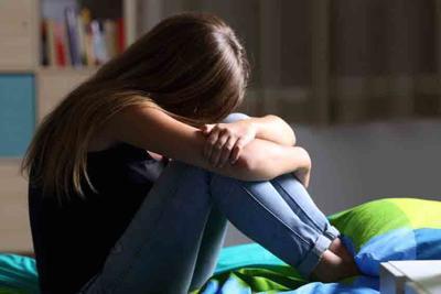Sad teen in her bedroom