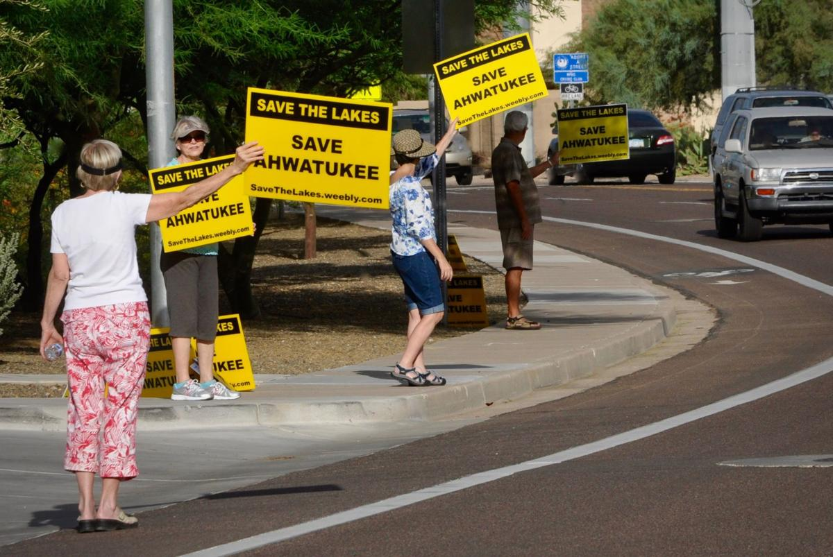 Protests like this by Ahwatukee Lakes residents who opposed True Life's agrihood concept occasionally sprouted up near the defunct golf course last year.