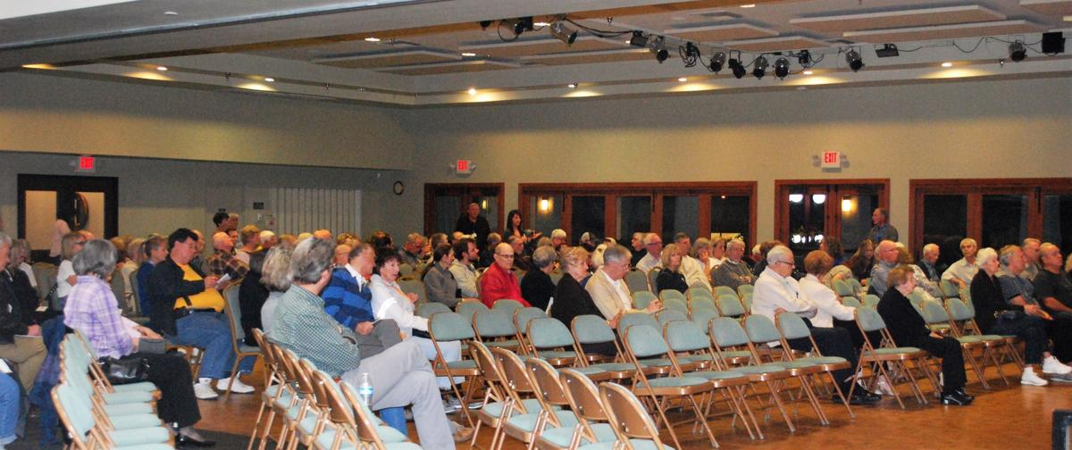 150 Lakes homeowners gathered two miles away at a Save the Lakes town hall to hear a half-dozen professionals condemn True Life and its plans