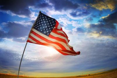 State budget plan would cut income taxes American Flag Tattered in wind