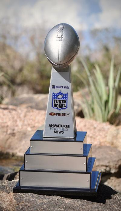 This trophy was created and donated by Times Media Group to become a traveling trophy for the winner of the annual Tukee Bowl (or Ahwatukee Bowl).