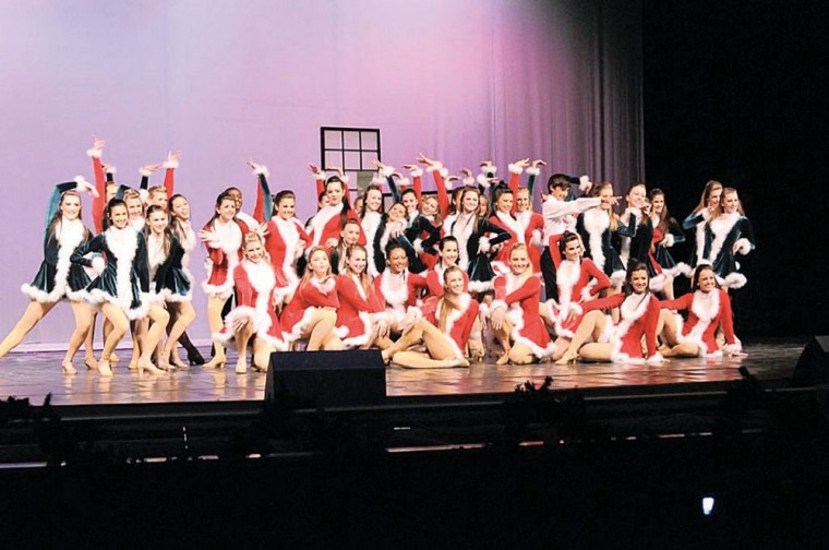 DVHS dancers wearing colorful Santa outfits