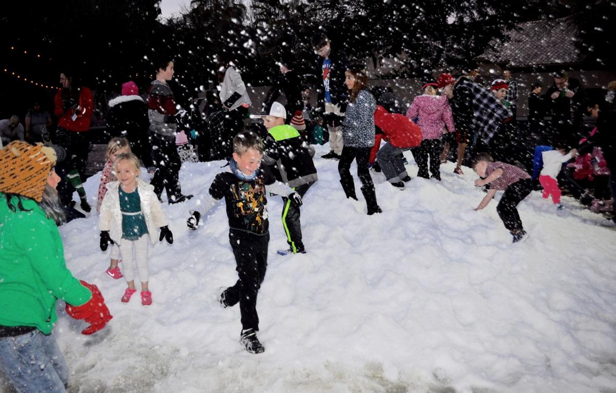 Kids of all ages enjoyed the 15-ton pile of snow dumped in the parking lot at Foothills Baptist Church's Snowy Night in Ahwatukee event last year.