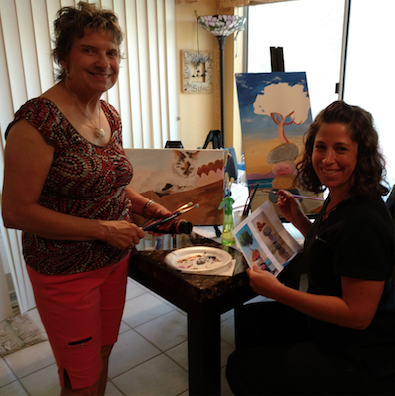 Ahwatukee artist Kathie Kelly, left, works with student Jen Winton in her studio.
