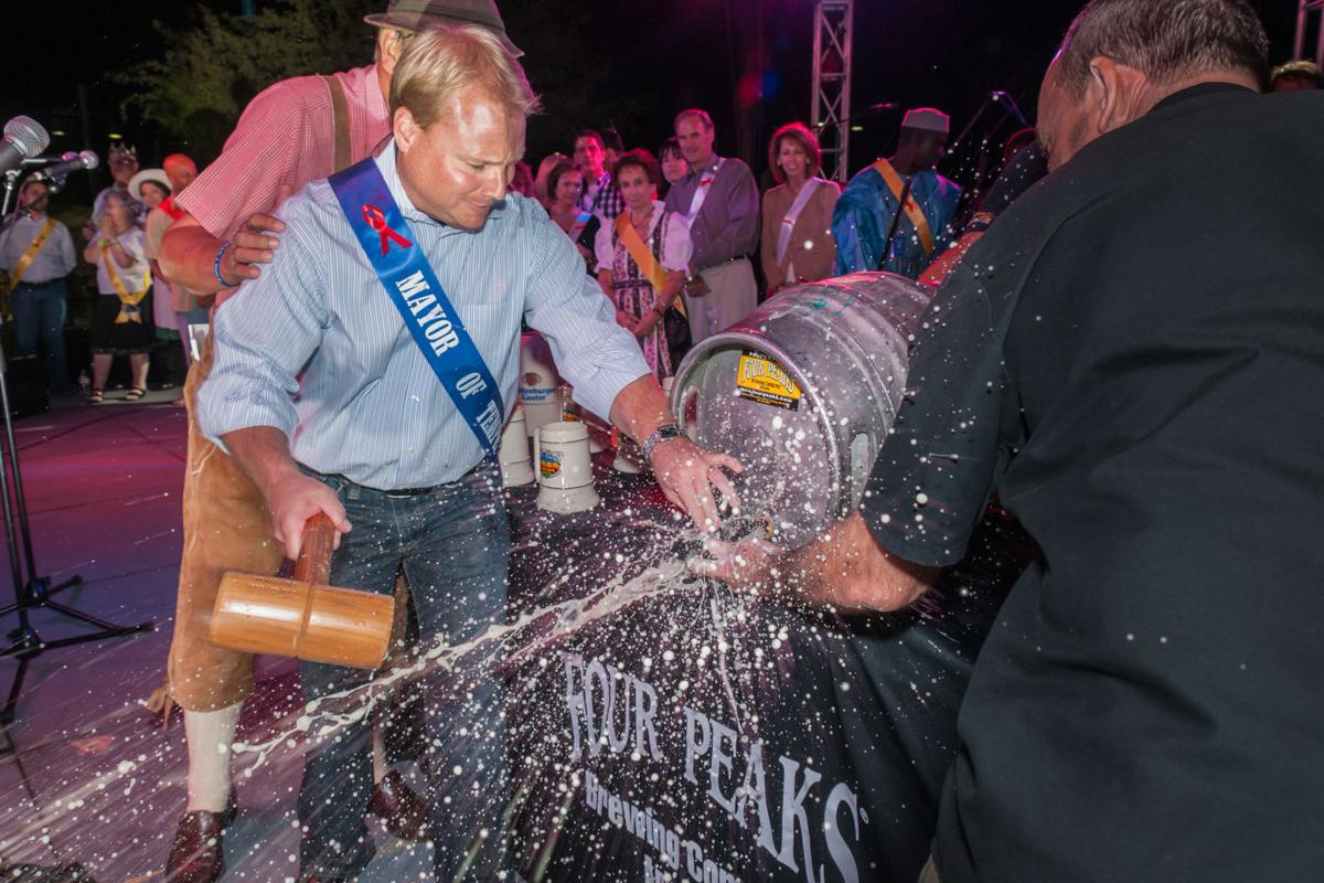 Tempe Mayor Mark Mitchell participates in a keg-tapping event at the annual Four Peaks Oktoberfest at Tempe Town Lake.