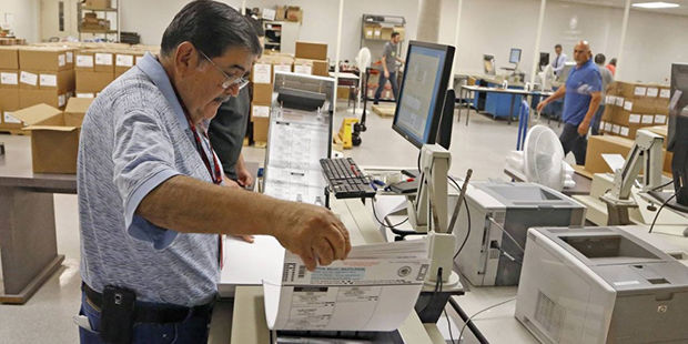 Ballots must be postmarked before 7 p.m. Tuesday, Nov. 7