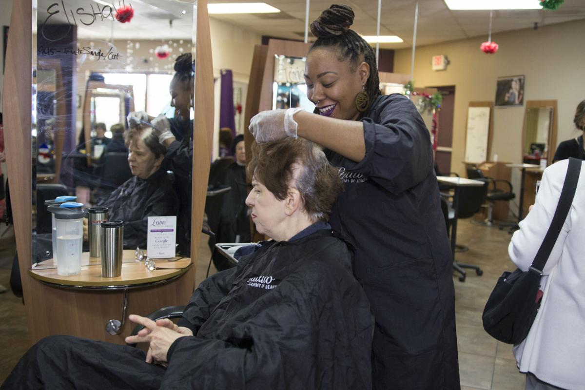 LouAnne Savolt of Sun Lakes gets her hair done by Elisha Davis, a student at The Studio Academy of Beauty in Chandler.