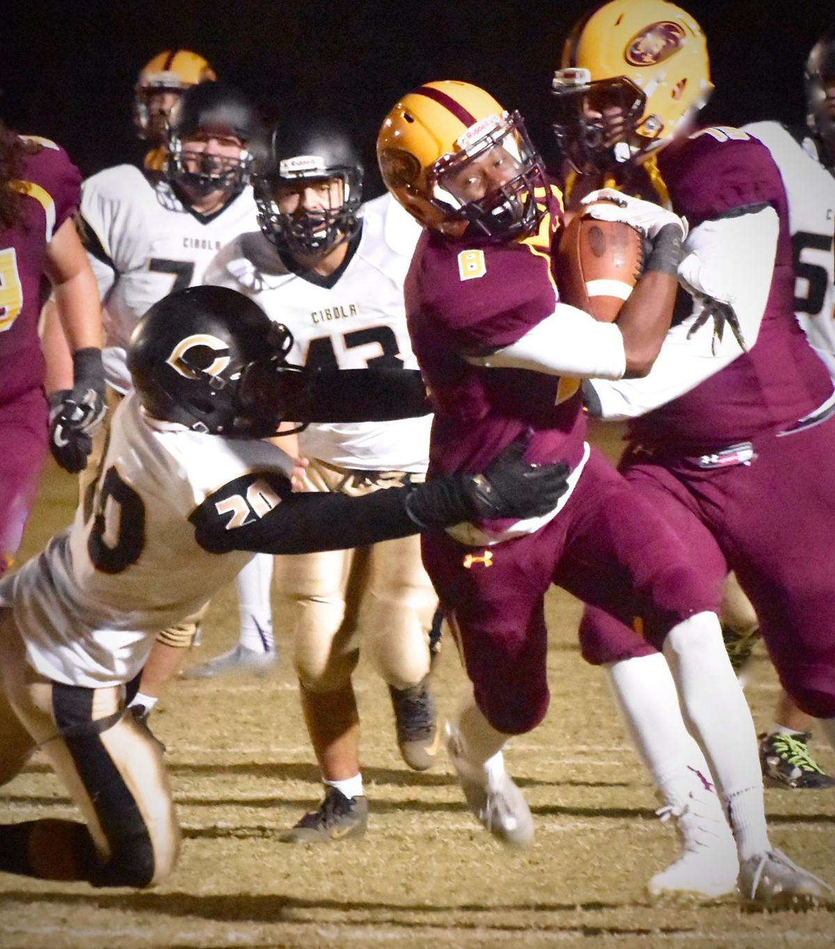 Mountain Pointe's Gary Bragg breaks a tackle as he powers his way toward the Pride's third touchdown.