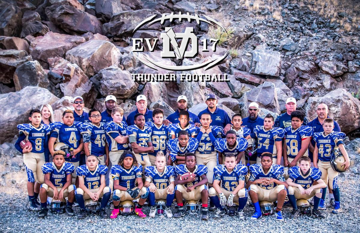 "Members of the EV Thunder team include, from left: bottom row: Tristian Halsana, Skyler Ritchie, Damien Logan, Jaxon Hacker, Cordell Killingsworth, Charles Hawk III, Portland Davis, Trey Liermann; middle row: Diego Pettypool, Santana Warren, Takoda Rivers, Johnathan Wadzeck, Nate Barlow, Dominic Costanza, Demetrice ""DJ"" Johnson (bending over) Elijah Kwan, Kameron Pender-Bey (bending over) Anthony Ruiz, Jordan Parker, Myles Carter and Ethan Green. Back roaw are: Row: Business Manager Sara Clute, coaches Dave Bills, Jordan Jarrett, Charles Hawk II, Chad Logan, John Pettypool, Ben Carter, James Ritchie and Aaron Kwan."