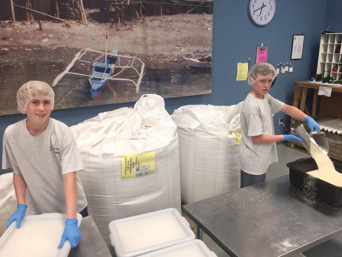 Max Kerkhove, left, and Christian Creech volunteered at Feed My Starving Children recently as part of their involvement in Boys Team Charity of Ahwatukee.