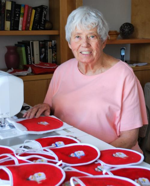 Vivian Giumette of Ahwatukee is making 200 Christmas bibs for Arizona Needy Newborns and has been a member of the group for years.