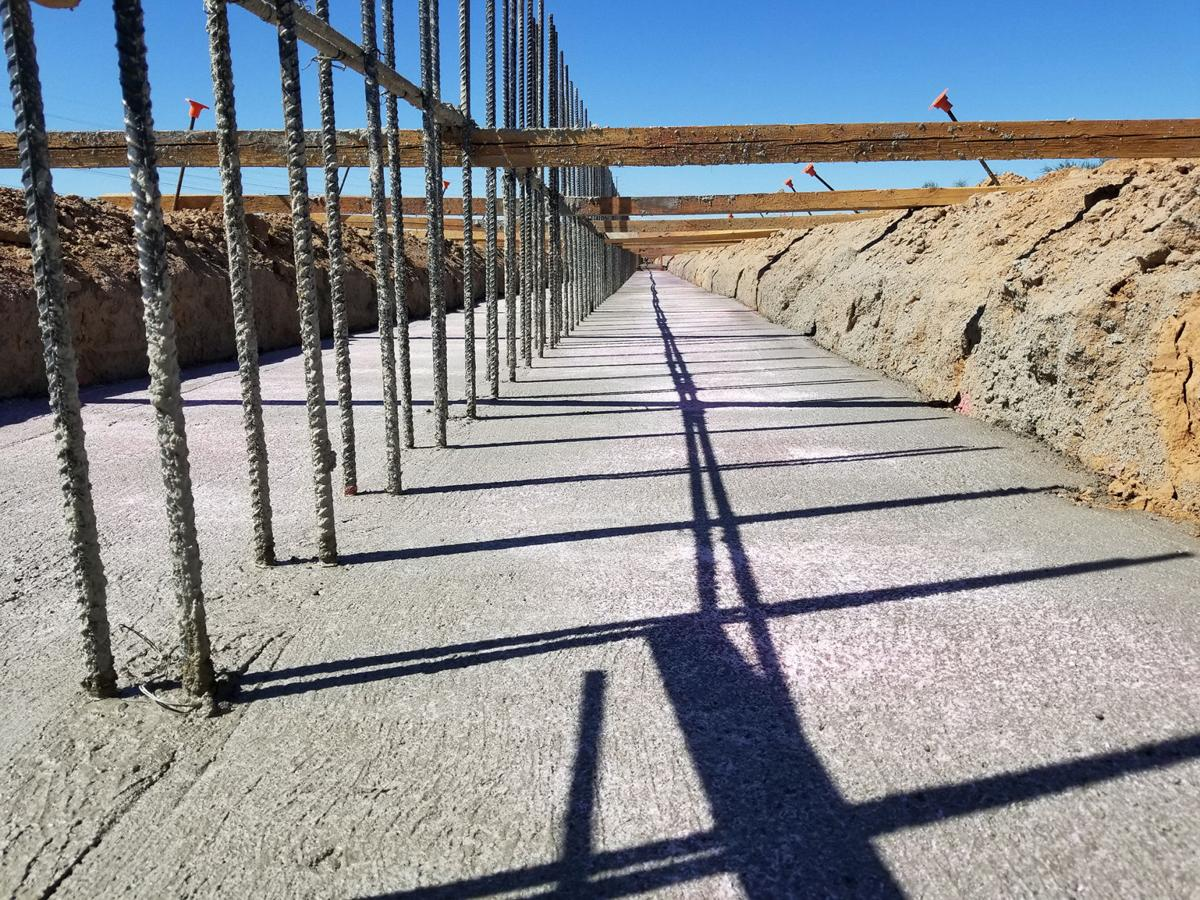 Pylons used to secure sound walls that will be 16 to 20 feet high are being set up along Pecos Road between 40th and 48th streets to curb noise from the South Mountain Freeway.