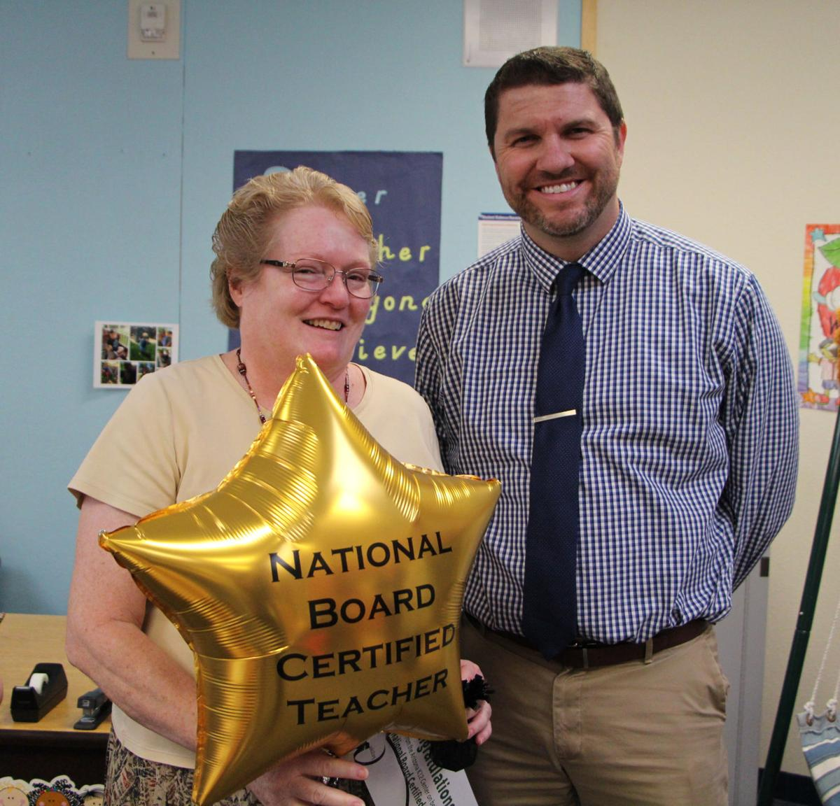 Michele McCuen is congratulated by Donnie Dicus of the Arizona K12 Center for achieving national certification