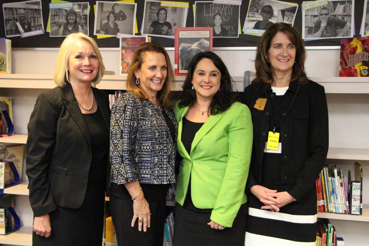 From left, Kyrene School District Superintendent Jan Vesely, Christine Burton of the Burton Family Foundation, Kyrene Governing Board member Bernadette Coggins and state Rep. Jill Norgaard celebrate the school district receiving a grant to help preschoolers with dyslexia.