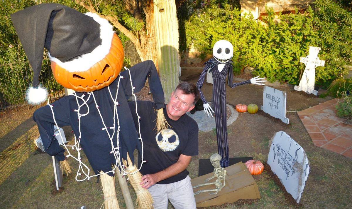 Steve Powers sets up a huge halloween display in his front yard, 2537 E. Amberwood Drive, Ahwatukee.