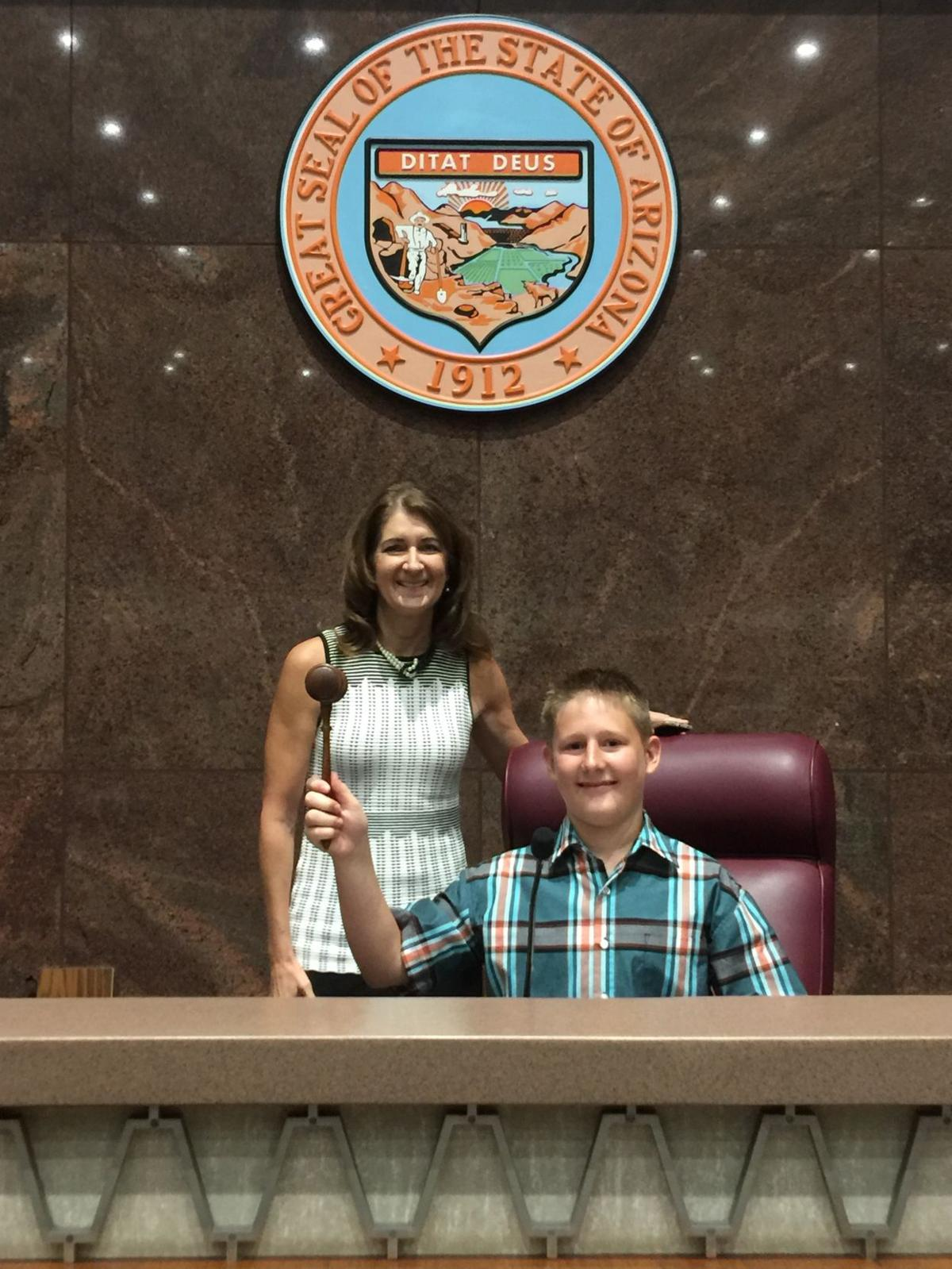 Thomas Allen of Ahwatukee raises a gavel during his tour of the State Capital in which state Rep. Jill Norgaard was both his guide and a big help in Thomas' quest for his Eagle Scout badge.