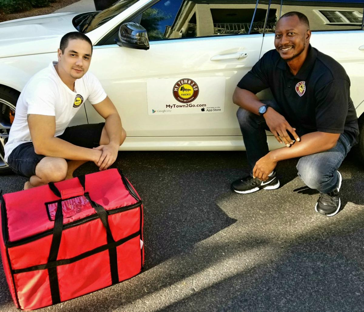 Josh Benjamin, left, and Cedric Robertson show off the kind of temperature-control delivery bags used by their their Ahwatukee business, MyTown2Go-Phoenix.