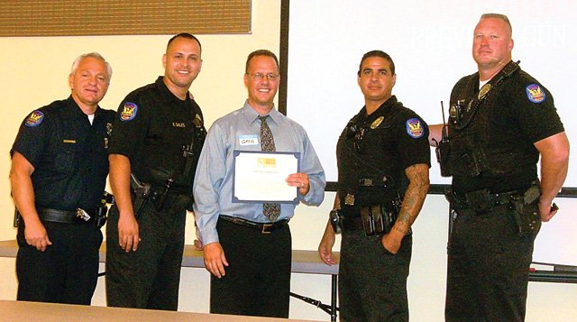 Local insurance agent receives police award