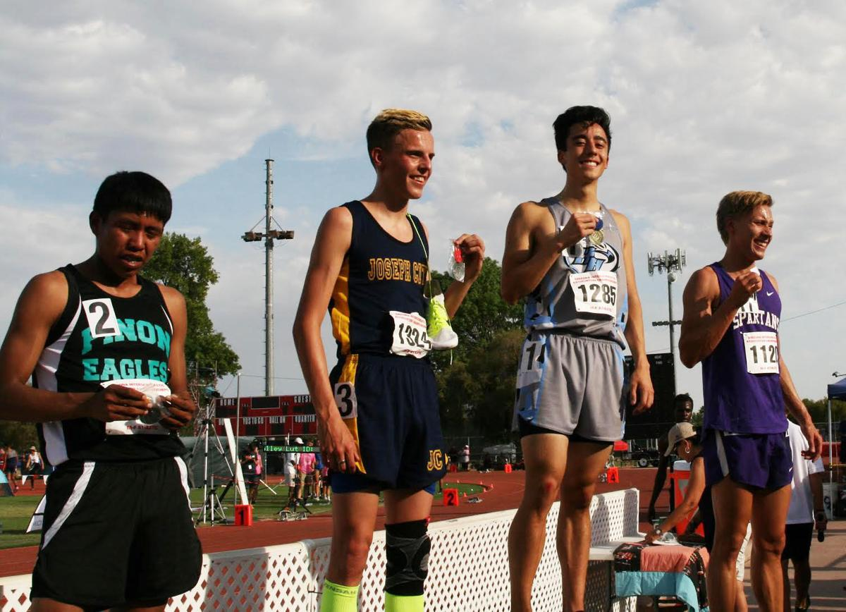 Trevor Tam (gray) stands atop the podium after winning one of this three state titles at the Division IV State Championsips held at Mesa Community College.