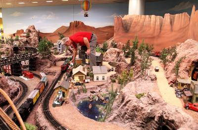 Roy Towne, a member of the Arizona Big Train Operators, checks on a train in the club's display at Cardon Children's Medical Center in Mesa