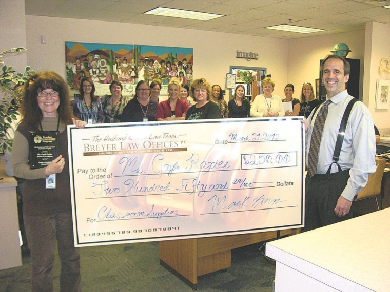 Ms. Gayle Rapier accepts check from Mark Breyer