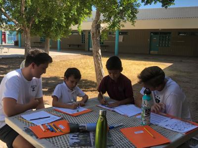 Desert Vista High School's Community Counts students work with second graders at Wilson Elementary School.